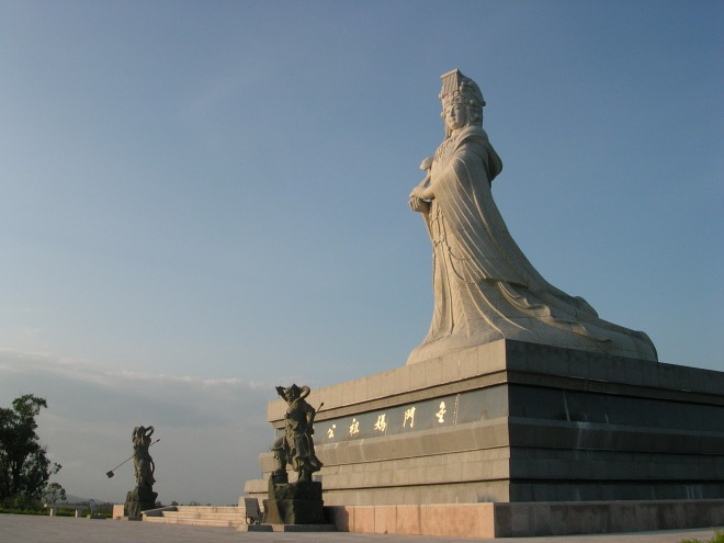 A statue of Mazu, with her two guardian generals.